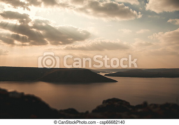 Majestic sunset in the mountains landscape over a calm lake - csp66682140