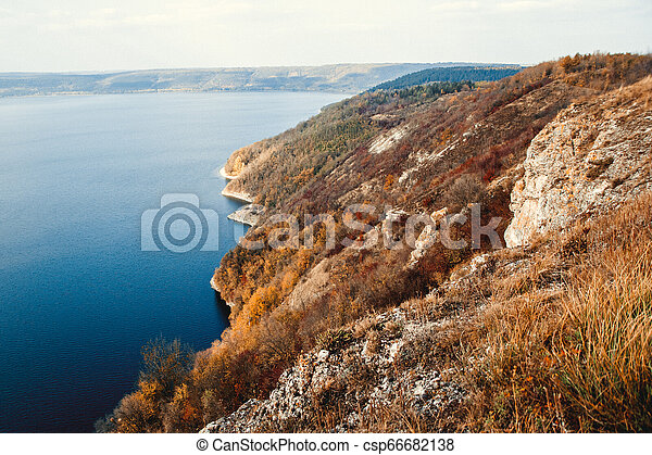 Majestic sunset in the mountains landscape over a calm lake - csp66682138