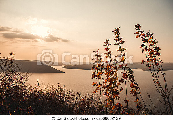 Majestic sunset in the mountains landscape over a calm lake - csp66682139