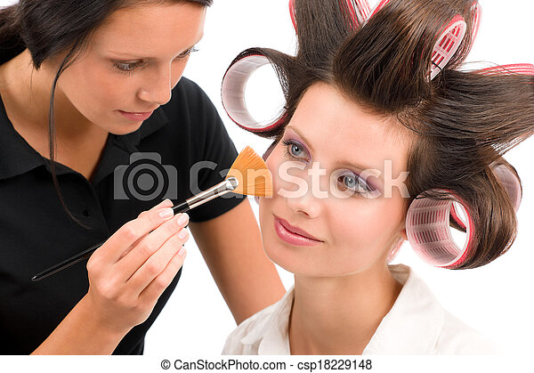 Make-up artist woman fashion model apply powder - csp18229148