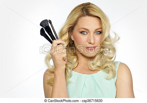 Makeup Artist With Brushes - csp36715630