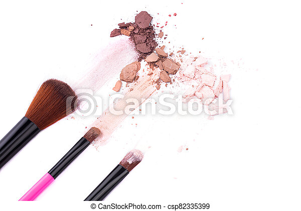Makeup brushes with eye shadow on a white background - csp82335399