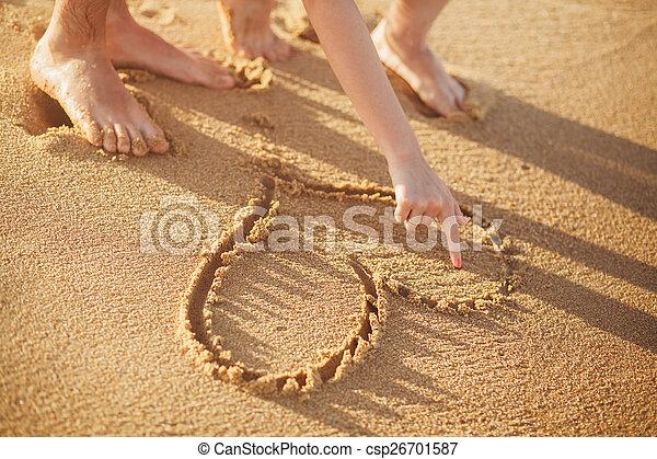 making heart on the beach - csp26701587