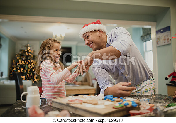 Making Messy Christmas Biscuits With Dad - csp51029510