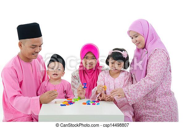 malay family playing and having quality time during hari raya - csp14498807