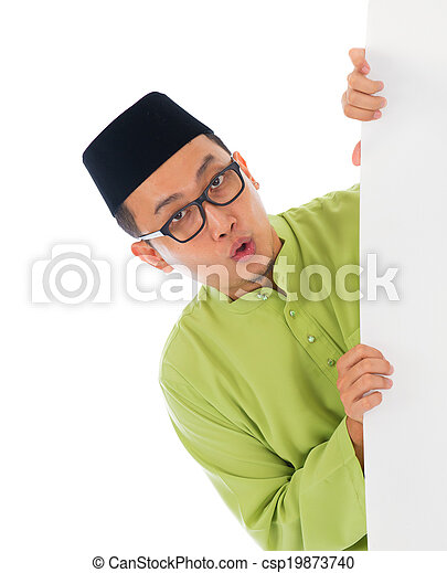 malay male with blank card during hari raya Eid al-Fitr aidilfit - csp19873740