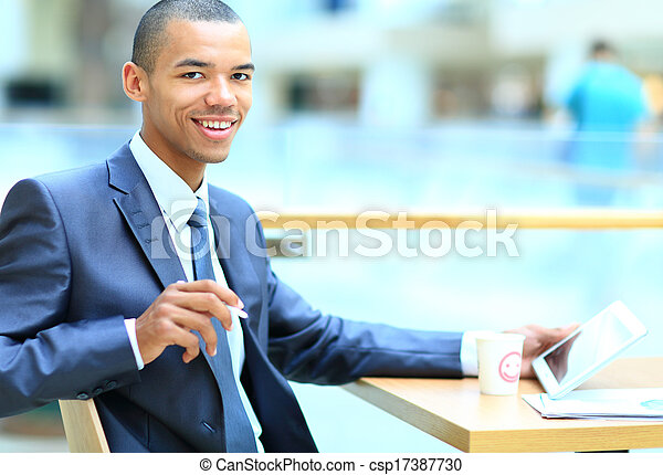 male african american office worker with tablet computer - csp17387730