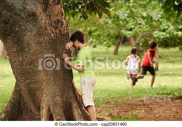 Male And Female Children Playing Hide And Seek Young Boys