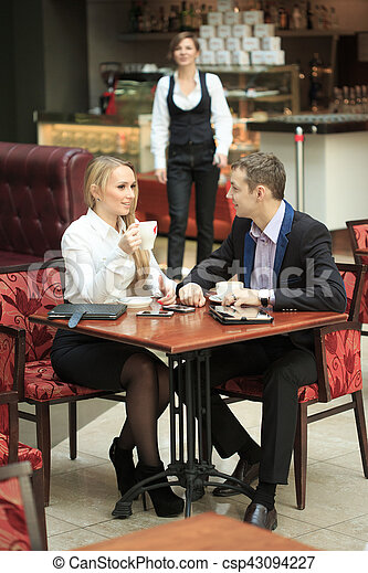 male and female colleagues in a cafe. - csp43094227