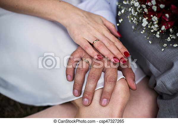 Which Hand Wedding Ring Female.Male And Female Hand With A Wedding Ring A Female Hand With Red Nails Manicure Love Bouquet Of Red And White Flowers Wedding Flowers Wedding