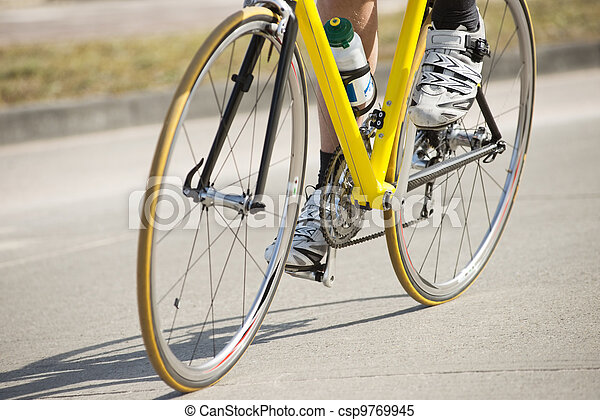 Male Athlete Riding Bicycle - csp9769945