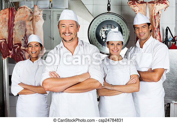 Male Butcher With Confident Team - csp24784831