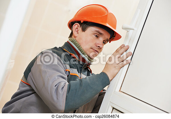 Male carpenter at lock installation - csp26084874
