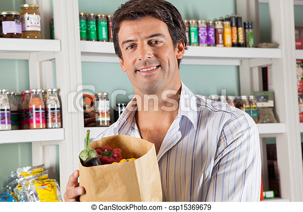 Male Customer With Vegetable Bag In Supermarket - csp15369679