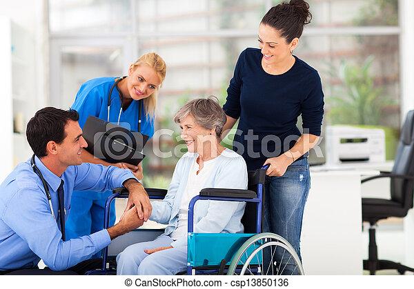 male doctor comforting senior patient - csp13850136