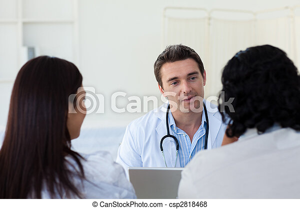 Male doctor explaining diagnosis to a couple - csp2818468