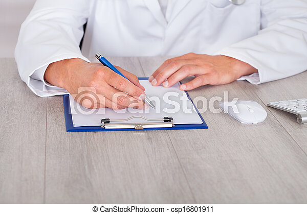 Male Doctor Filling Form - csp16801911