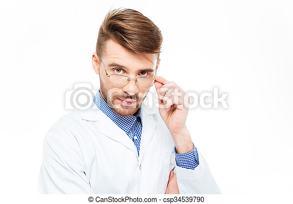Male doctor with glasses looking at camera - csp34539790