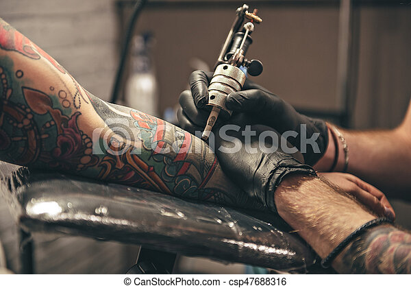 Male doing image on arm - csp47688316