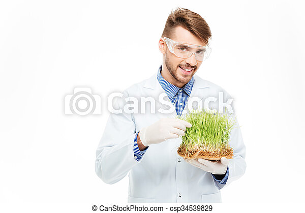 Male engineer showing a modified plants - csp34539829