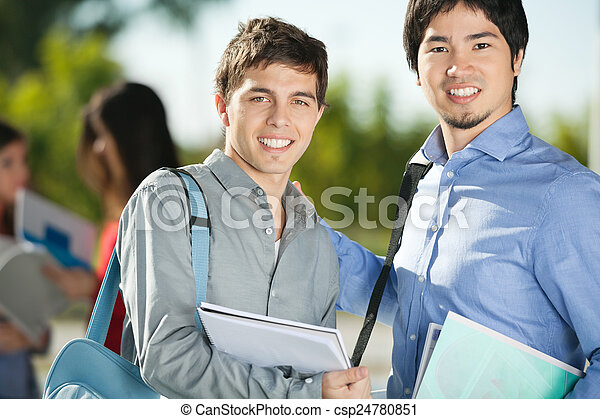 Male Friends Smiling On College Campus - csp24780851