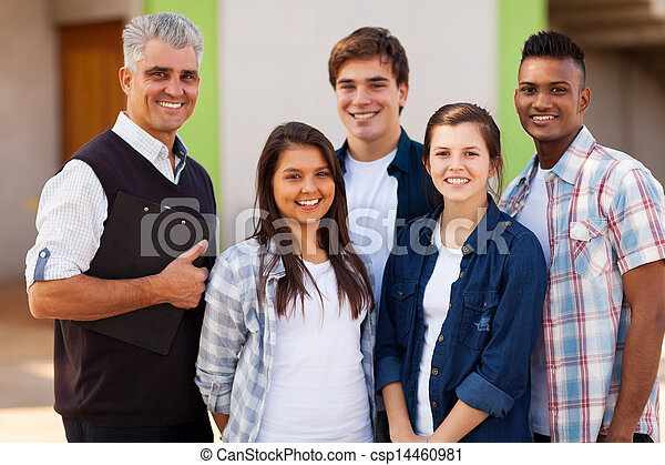 male high school teacher standing with students - csp14460981