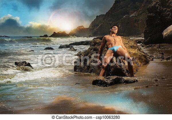 Male model on beach - csp10063280