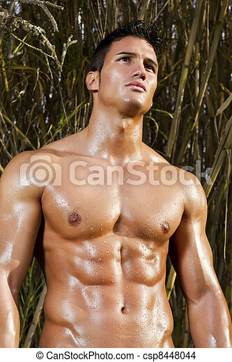 View Of A Very Fit Male Model With Muscles On The Countryside