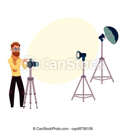 Male Photographer Taking Pictures Shooting In Studio And Photo Equipment