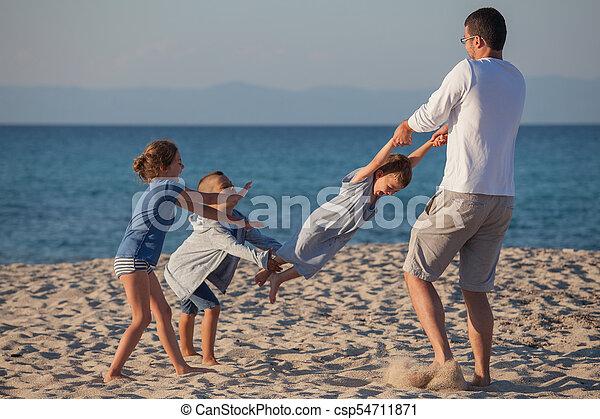 Male Playing Kids Carousel - csp54711871
