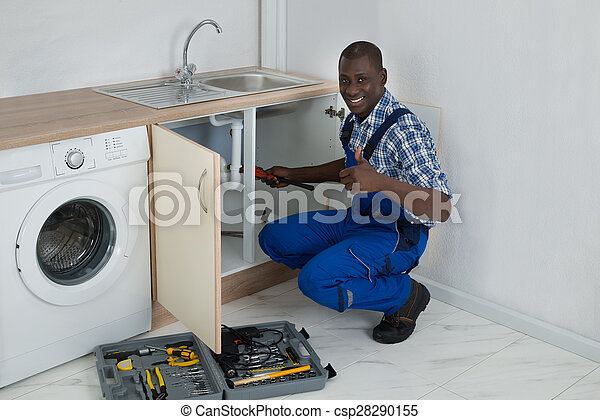 Young happy african male plumber fixing sink in kitchen stock images ...