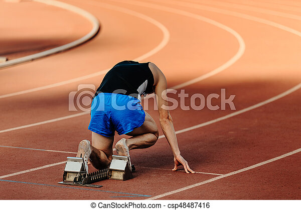 male runner starting blocks - csp48487416
