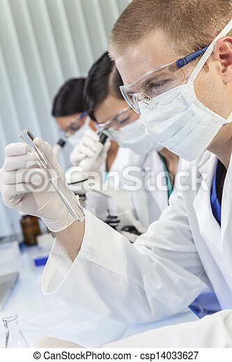 Male Scientist or Doctor With Test Tube In Laboratory - csp14033627