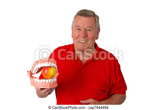 Male senior with teeth modell - csp7944494