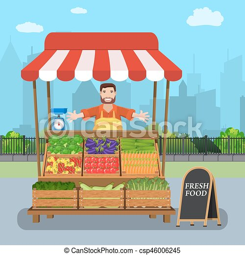 male street vendor selling vegetables from his stall on ...