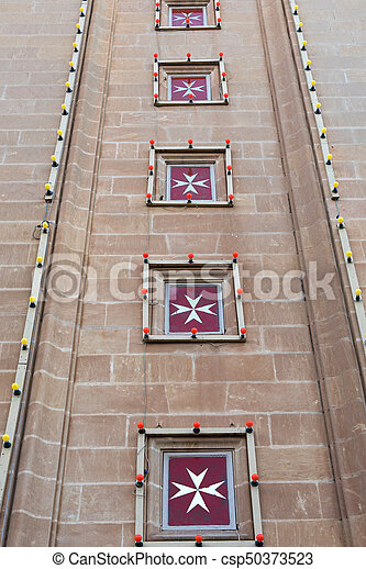 Maltese cross is the symbol associated with the Order of St. John - csp50373523