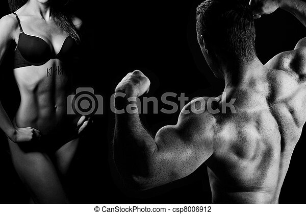 man and a woman in the gym - csp8006912