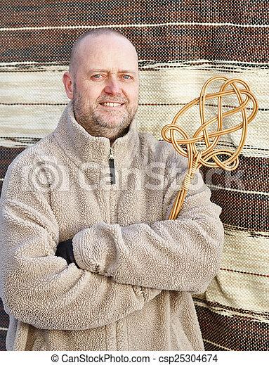 Man and carpet beater - csp25304674