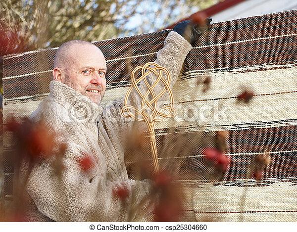 Man and carpet beater - csp25304660