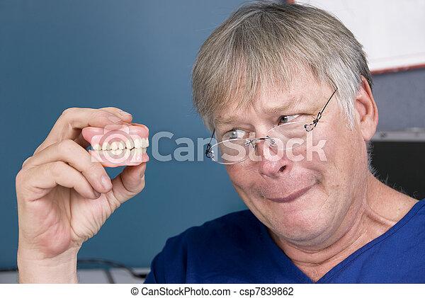 Man and his dentures - csp7839862