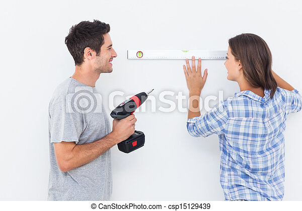 Man and his wife doing diy together - csp15129439