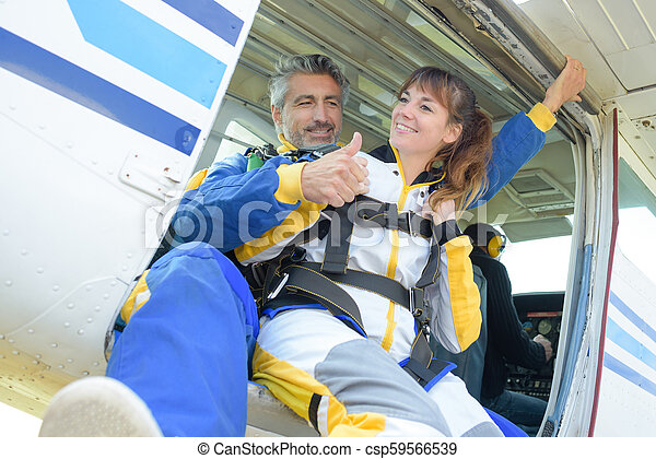 Man and lady poised to do a tandem skydive - csp59566539