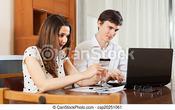 Man and woman buying online - csp20251061