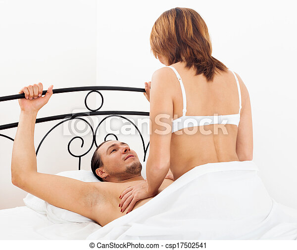A man having sex with a woman
