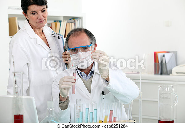 Man and woman in laboratory - csp8251284