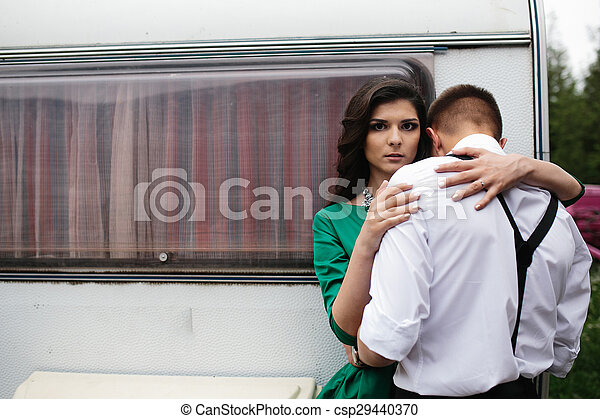 man and woman is hidden from view behind a trailer - csp29440370