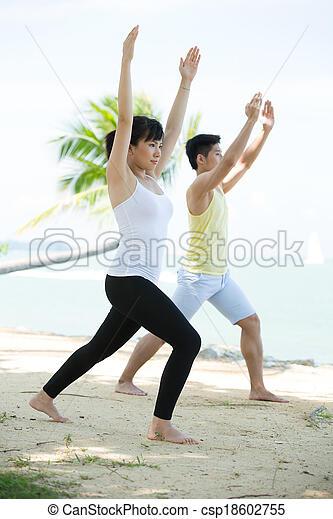 Man and Woman performing yoga. - csp18602755