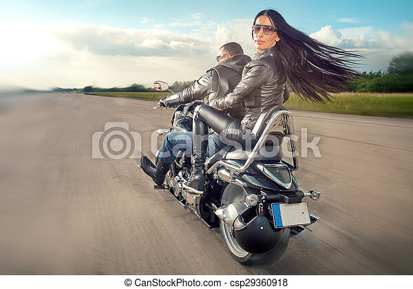 Man and woman riding on motorcycle - csp29360918
