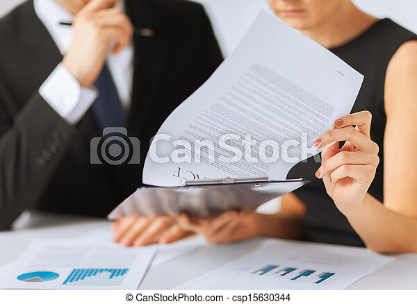 man and woman signing contract paper - csp15630344
