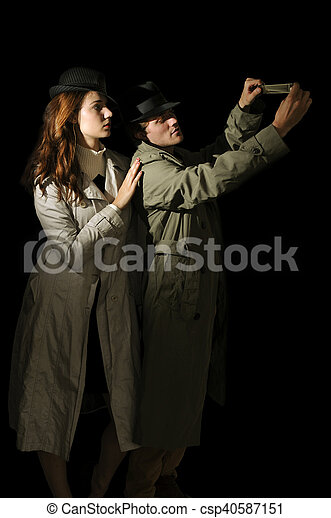 Man and woman spies - csp40587151